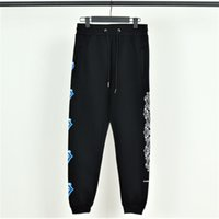 calça jeans pés venda por atacado-Mens de luxo famoso de Hollywood sweatpants Chromes corações jeans de grife Azul grande língua com calças de veludo Feixe de pé casual casal calças