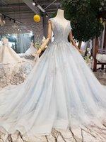 baby blau brautkleider großhandel-2019 Luxus Baby Blue Perlen A-Linie Brautkleider Dubai Arabisch Tiefem V-Ausschnitt High Neck Lace Pailletten Plus Size Brautkleid