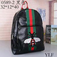 bolsos de diseñador de moda masculina al por mayor-Hot Backpack Designer 2019 Fashion Male Lady Black Backpack Charm Envío gratis Bolsa de hombro Inclinada Bolsa