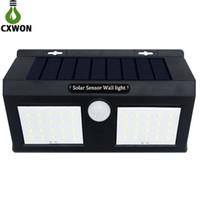 lámparas de pared de energía solar al por mayor-Sensor inteligente y energía solar 20 LED Luz de pared Sensor de movimiento PIR Lámpara de seguridad para exteriores Lámpara de pared impermeable para jardín Luces de paisaje
