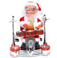 poupées de batterie achat en gros de-Jouets de Noël en mouvement Figurines Musique de Noël drôle à la main avec batterie Père Noël Poupée pour ornements cadeaux enfants