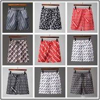 materiais de tabuleiro venda por atacado-Iduzi Novo polos verão shorts Men board shorts sólidos material seco rápido 9 cores Tamanho M-XXL Frete grátis
