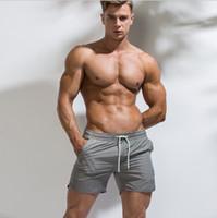 roupa orgânica da praia venda por atacado-Mens ployester calça curta esporte de verão Calções para homens Mans roupas orgânicas Calças curtas de praia Basculador básico pantaloncini Natação Swimwear