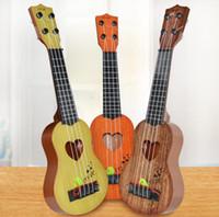 simulação de guitarra venda por atacado-39 cm / 44 cm Mini Ukulele Simulação Guitarra Crianças Instrumentos Musicais Brinquedo Educação Musical Desenvolvimento Crianças Aniversário Presente De Natal