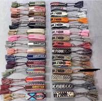 bordado de pulseira venda por atacado-Marca pulseira de tecido de algodão Mulheres D Assinatura tecido Jewelry Letter bordado Handmade Bracelet Tassel Lace-up amizade D Pulseira marca