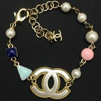 harz armbänder großhandel-Luxuriöses Qualitätsfrauen-Charmearmband mit Harz und Perle verzieren und Logohochzeitsgeschenktropfenverschiffen PS5393A