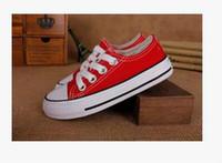 zapatos baratos del envío de los precios bajos al por mayor-Envío gratis precio bajo para niños zapatos de lona zapatillas de deporte de moda alto-bajo niños niñas zapatos deportivos de lona estrella del deporte zapatillas niños