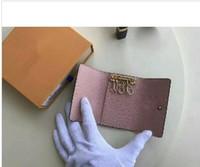 touches plus achat en gros de-Haute qualité Famous nouvelles femmes hommes en cuir Plus couleur classique 6 porte-clé couvrir avec sac à poussière carte porte-clés