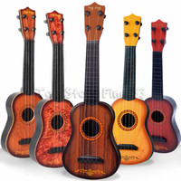 mini brinquedo de guitarra venda por atacado-Mini 16 polegadas Novato Clássico Seguro simples Ukulele Guitarra 4 Cordas Educacionais Instrumento Musical Instrumento de Concerto de Brinquedo para Crianças Presente de Natal