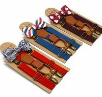 clip bébé garçon achat en gros de-Enfants réglables bretelles bébé plaid bretelles enfants clip de sangle avec noeud papillon 9 couleurs ceintures VVA350