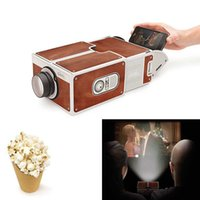 mini mobile home projector achat en gros de-Mini téléphone portable Projecteur de cinéma portable DIY Smartphone Projection Projecteur de téléphone portable pour la maison projecteur Audio Vidéo cadeau