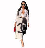 женские юбки оптовых-Новое поступление элегантный контрастный цвет письмо печатных плиссированные юбки лоскутное эластичный пояс юбки-линии Женщины Повседневная партия макси платье