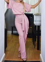 mamelucos coloridos al por mayor-Botón colorido de manga corta para mujer monos verano cuello redondo ahueca hacia fuera el lápiz pantalones pantalones mamelucos ropa de moda