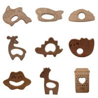 Wholesale wooden giraffe toys online - 100pcs Handmade Natural Beech Wood animal shark tent Ankylosaurus sloth Teether Teething Giraffe Shape Baby Kids Chew Toy