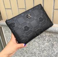 männer europäische schultertaschen großhandel-HOT !!! Neue Stil Europäischen Amerikanischen männer Designer Schulter Brieftasche Kopf Print Hand Greifen Handtaschen herrenmode Umhängetasche