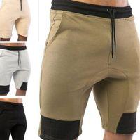 ingrosso abiti da palestra-Uomo Palestre pantaloncini con tasche Bodybuilding Abbigliamento Uomo Atleta fitness Bermuda allenamento di sollevamento pesi in cotone 4