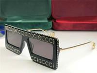 ingrosso moda nuova occhiali-donne nuovi occhiali da sole di design 0431 bling bling telaio lucido stile moda occhiali a gabbia design quadrato con lente caso UV400