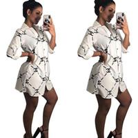 ingrosso pulsante nero camicia manica lunga-Camicette stampate da donna Bottoni manica lunga risvolto sexy bianco nero Camicie Top Camicie casual da donna Abito Mini abito Streetwear Abbigliamento donna