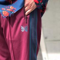 bordado para calça esporte venda por atacado-19FW Agulhas ASAP Rocky Botão Calças borboleta Bordados Sweatpants Stripe Casual Calças Casal Sports Pants Fashion Street HFYMKZ182