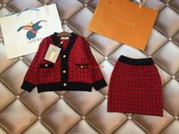 hilo tutu al por mayor-Faldas para niñas conjunto otoño moda niños ropa de diseñador cardigan de punto + falda 2 piezas conjuntos de material de hilo de tejer