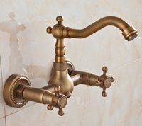 Wholesale brass wall mounted tap resale online - 180 Degree Rotating Faucets Antique Brass Bathroom TapS Bath Mixer Fashion vintage Dual Handle hot and cold wash basin Faucets