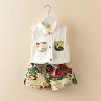 ingrosso fiocchi di fiori floreali bambini-Set di vestiti per bambina per bambina con tasche monopetto stampate con bottoni in cotone con maniche corte per bambini vestiti estivi per bambini