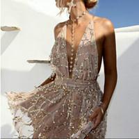 vestidos casuales de oro blanco al por mayor-Vestidos de fiesta Vestidos atractivos Mujeres sin espalda Halter Negro Mini vestido de fiesta Vestido de verano con borla Club de las mujeres usan blanco
