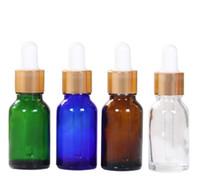 mini botellas de vidrio para aceites esenciales. al por mayor-5 ml / 10 ml / 15 ml Botella de gotero de vidrio para botella de aceite esencial Perfume mini Botella portátil Vacío cosmético Transparente gotero Vial