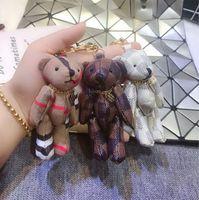 полки для автомобилей оптовых-2019 новые полки мода плед медведь брелок милый совместный медведь сумка кулон мужчины и женщины творческий мультфильм кукла автомобиль украшения