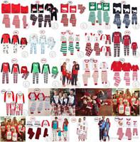 pijamas de mujer al por mayor-Familia juego pijama de Navidad Conjunto de 25 diseños Red Letters reno de Nightclothes ropa de dormir pijamas para hombres mujeres niño al por mayor de DHL 2018