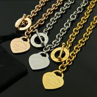 ingrosso ot gioielli d'oro-Titanio acciaio T a forma di cuore circolare OT foro spessa titanio amore collana fibbia donne in oro rosa collana moda uomo gioielli all'ingrosso