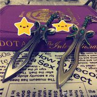 prix bague homme achat en gros de-Prix bas DOTA2 jeu papillon épée arme bronze porte-clés en métal porte-clés garçons cadeau T89