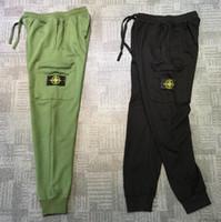 calças de swat preto venda por atacado-19 novas calças dos homens designer de moda feixe de algodão calças versátil calças de alta qualidade homens e mulheres estilo calças frete grátis