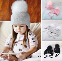 Wholesale female hat hair resale online - Autumn And Winter Baby Hat Male And Female Hair Ball Knitted Hat Pearl Fastening Ear Cap Lovely Warm Parent child Cap Tide EEA205