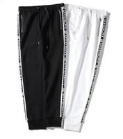 xxl moda mujer pantalón al por mayor-2019 diseñador cadena Logo hombres mujeres Joggers Casual Harem Pantalones deportivos Pantalones deportivos Moda hombre impresión Pantalones de movimiento XXLGivenchy