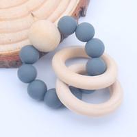 silikonfingerringe großhandel-Natürliche Holz Ring Beißringe für Baby Health Care Zubehör Infant Finger Übung Spielzeug Bunte Silikon Perlen Schnuller