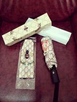 ingrosso ombrello rosa chiaro-Lettera di marca G Little Bees Ombrello Donna Uomo lusso Classic Style Camellia Ombrello 3 Fold Vendita calda LOGO Ombrello Antivento con confezione regalo