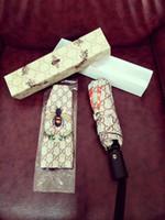 kleine geschenkboxen großhandel-Marke Brief G Little Bees Regenschirm Frauen Männer Luxus Klassischen Stil Kamelie Regenschirm 3 Falten Heißer Verkauf LOGO Regenschirm Winddicht mit ...