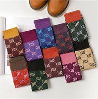 носки для конфет оптовых-Горячая осень новый цвет конфеты письмо куча куча Женские носки мода тенденция многоцветный дикий хлопок носки