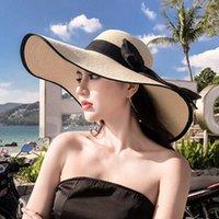dobradura de fita venda por atacado-Mulher da praia de palha Chapéu de Sol Verão Casual Aba larga Sólidos Folding Hat Lady Ribbon Praia Floppy bowknot Cap TTA-1036