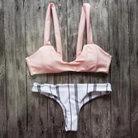 caliente sexy chicas rosa bikini al por mayor-Doble lado vistiendo mujeres sexy rosa micro tanga bikini conjunto traje de baño caliente chicas piscina fiesta atractivo acolchado trajes de baño trajes de baño