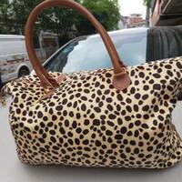 frauenbeutelhandgriff großhandel-Frauen Leopard Reisetasche Reisetasche Handtasche Doppelgriffe Sarah große Kapazität Outdoor Lady Party Weekenders Tasche LJJA2409