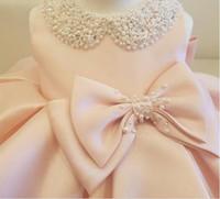 neue baby taufkleider großhandel-2019 neue Mode Perlen Bogen Blumenmädchenkleider Für Hochzeit Prinzessin Flauschigen Tüll Baby Mädchen Taufe 1. Geburtstag Kleid