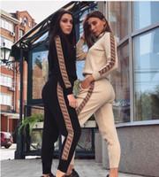 tampa média venda por atacado-111 Novo estilo de marca Designer de desgaste das mulheres Cap com capuz mangas compridas Jacket + calças Impresso roupas alfabéticas desgaste das mulheres