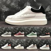 zapatos deportivos de los hombres de moda al por mayor-2019  Alexander McQueen Comfort Trendy Fashion Designer Luxury Men Casual Shoes Womens Triple White Black MC Real Low Cut Leather Zapatillas deportivas 35-44