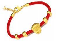 pulsera de imitación china al por mayor-Transporte del cerdo dorado: pulsera de hilo rojo con cuerda de imitación de oro. Cuerda roja de los amantes de la cuerda roja de Benmingnian. Pulsera del zodiaco chino.