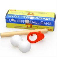 bolas de espuma mágica al por mayor-Blow Magic ball game clásico para niños temprano educativo divertido rompecabezas de madera Magic Toy para niños Foam Floating Magic Ball