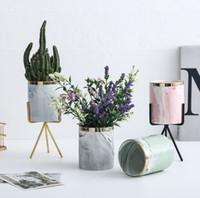 ingrosso vasi di piante verdi ceramiche-Nordic high-end vaso di fiori in marmo modello carnoso vaso di fiori in ceramica in ferro battuto vaso in ferro telaio stand verde pianta verde vasi di fiori insieme
