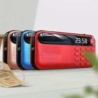 haut-parleur portable de batterie de lecteur mp3 achat en gros de-Radio FM portable Haut-parleur extérieur Maison Carte TF Lecteur de musique U Disque mini-mp3 Horloge Sortie casque 18650 Batterie rechargeable
