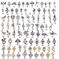ingrosso hollow locket pendant-85 Style Opzionale Ciondolo gabbia di perle Hollow Animal Aromaterapia Diffusore di olio essenziale di diffusore di olio essenziale per il braccialetto della collana Gioielli alla rinfusa